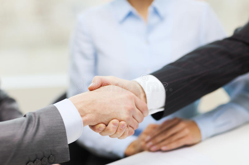 Download Two Businessmen Shaking Hands In Office Royalty Free Stock Image - Image: 38529386