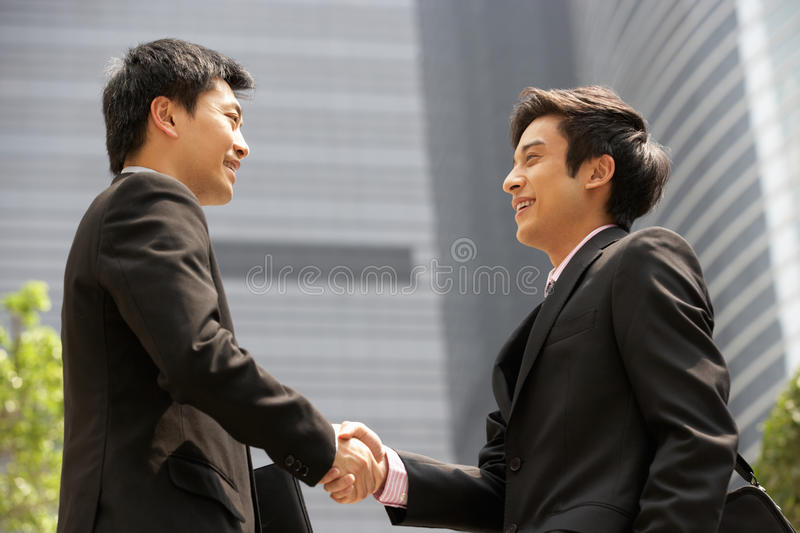 Download Two Businessmen Shaking Hands Outside Office Stock Image - Image: 26094745