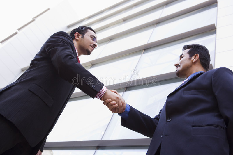Download Two Businessmen Shaking Hands Outside Office Build Stock Image - Image: 5290787
