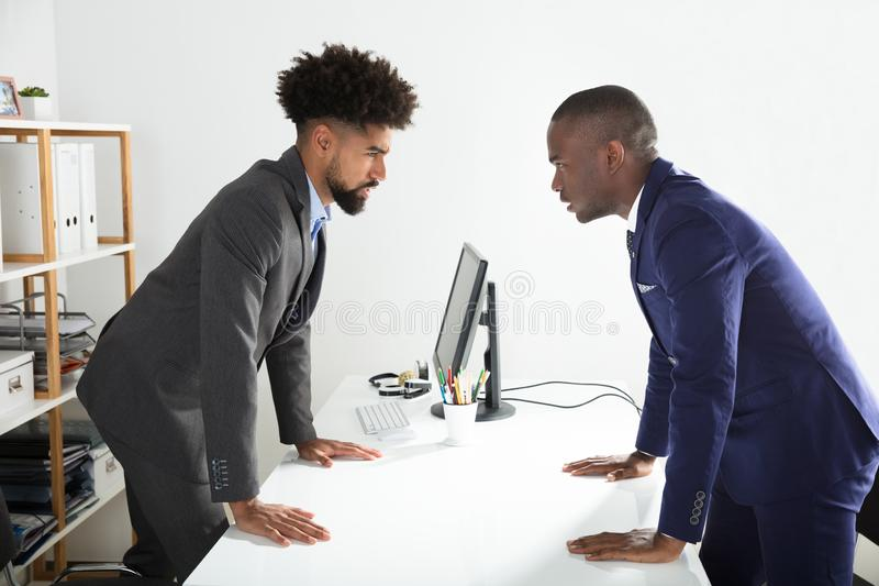 Two Businessmen Shouting At Each Other stock image