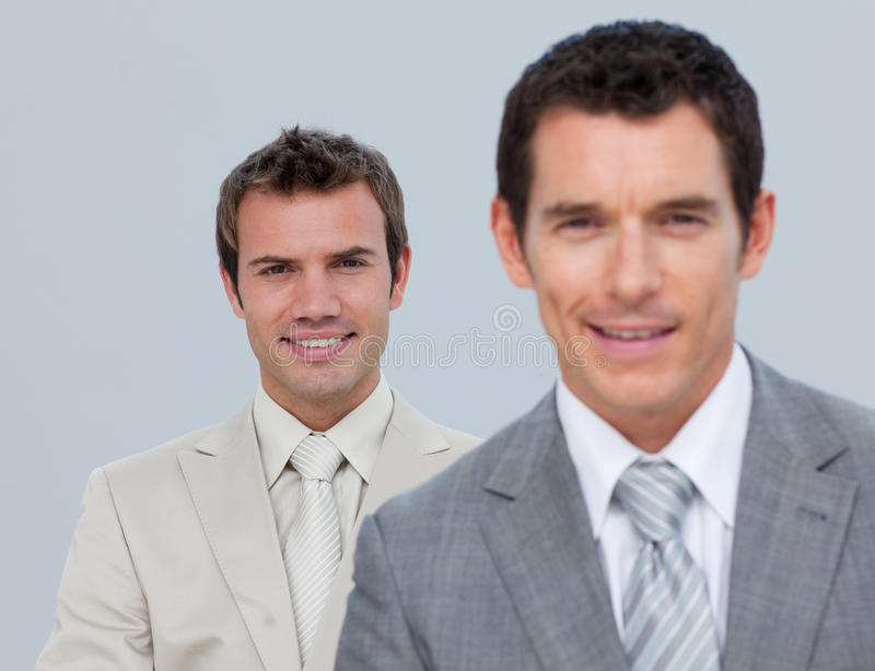 Two businessmen smiling at the camera stock photography