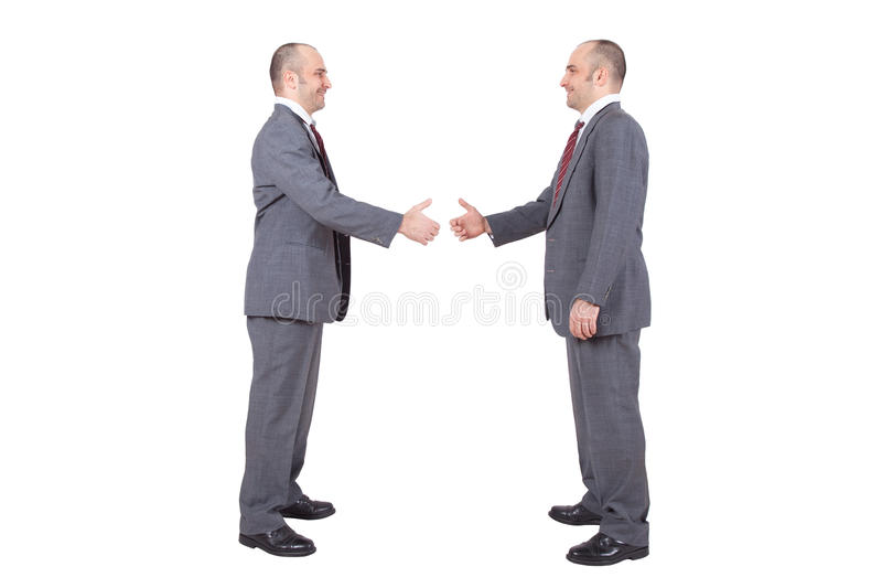 Businessmen shaking hands royalty free stock image