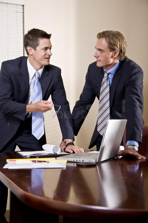 Download Two Businessmen In Suits Working In Boardroom Royalty Free Stock Photos - Image: 15641548