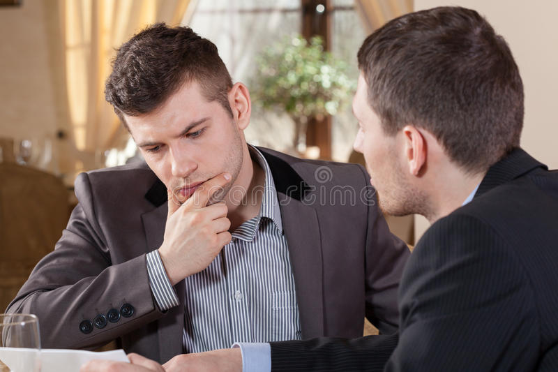 Two businessmen talking about an offer royalty free stock images