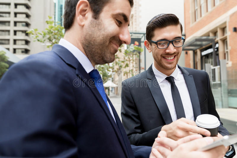 Two businessmen talking outdoors. While taking coffee break royalty free stock photography