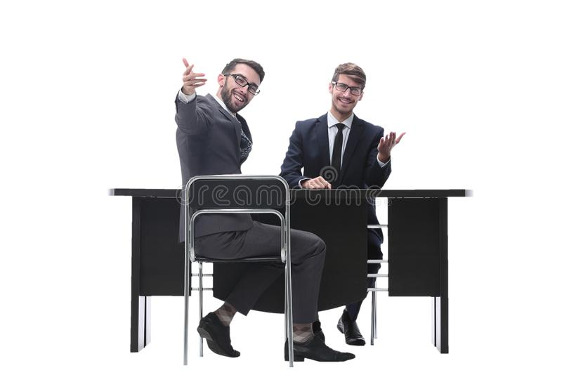 Two businessmen talking, sitting at his Desk. Isolated on white background royalty free stock photos