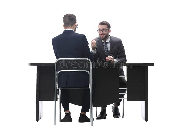 Two businessmen talking, sitting at his Desk. Isolated on white background stock photo