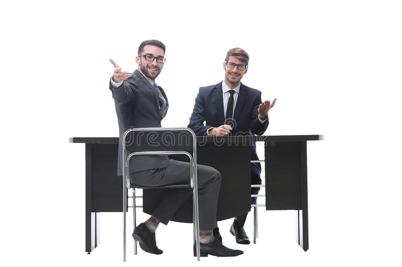 Two businessmen talking, sitting at his Desk. Isolated on white background stock images