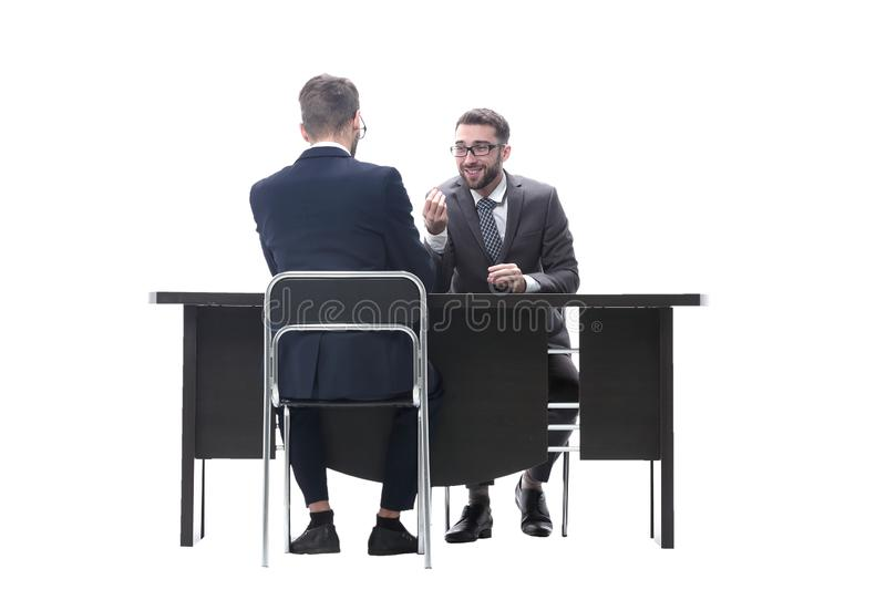 Two businessmen talking, sitting at his Desk. Isolated on white background stock photos