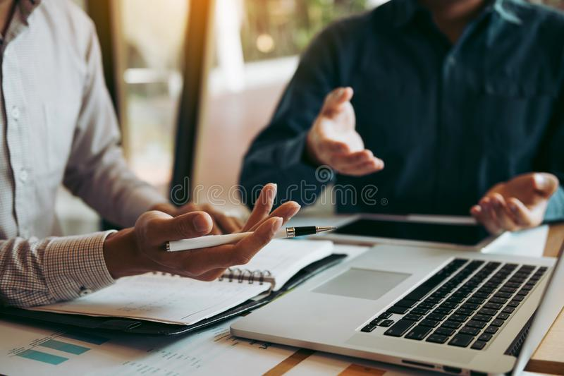 Two businessmen are talking about the wrong financial budget of the company and the correct analysis.  stock photography