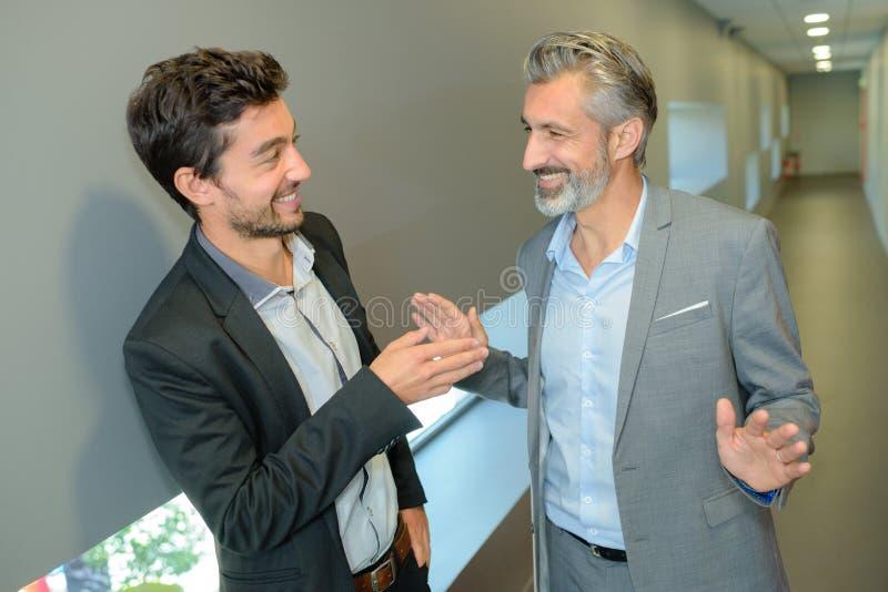 Two businessmen talkingwhile taking coffee break royalty free stock photos