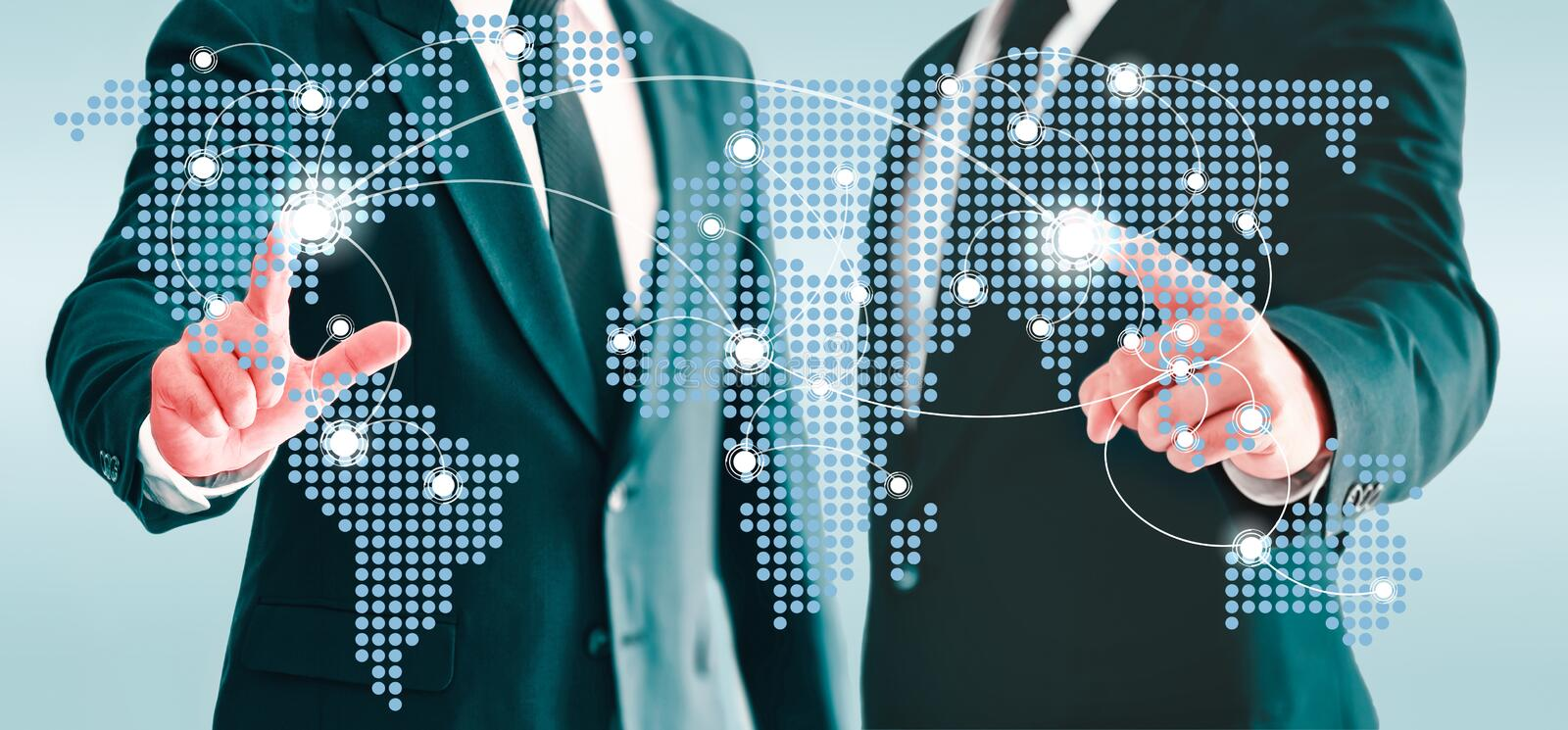 Two businessmen touching world map virtual button. Concepts of information and business contacts interconnected world stock photo