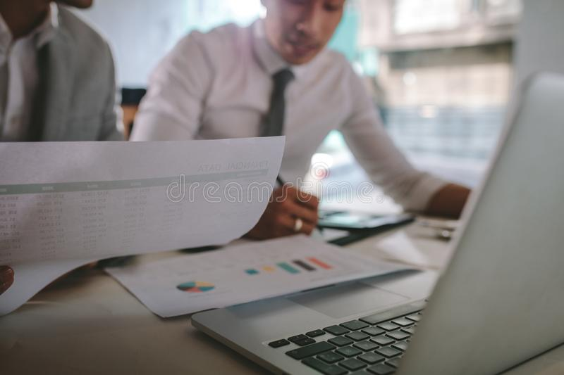Two businessmen working together over documents royalty free stock image