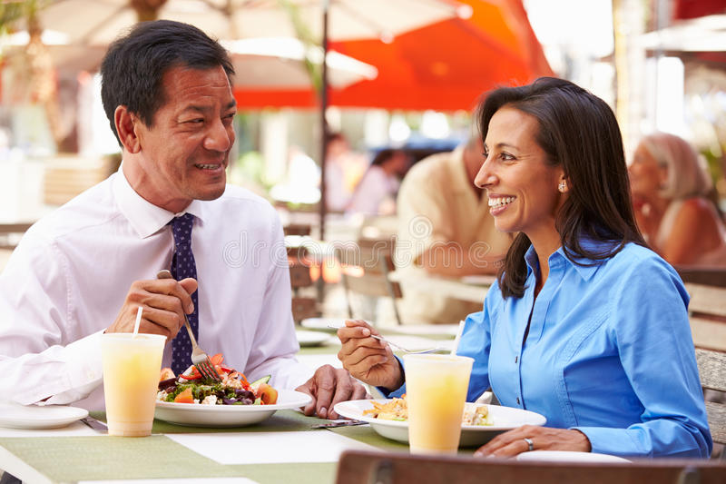 Two Businesspeople Having Meeting In Outdoor Restaurant royalty free stock photo
