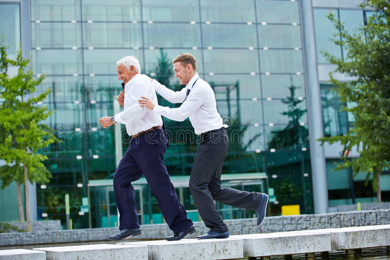 Two businesspeople jogging in city royalty free stock photo