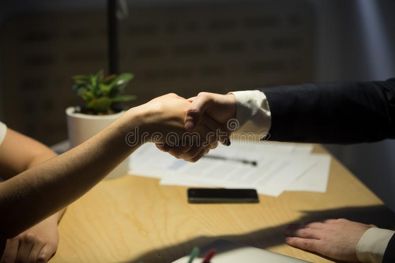 Two businesspeople shake hands to seal a deal. Two businesspeople shake hands to seal a deal, recruiter employing new staff member, human resources manager stock photos