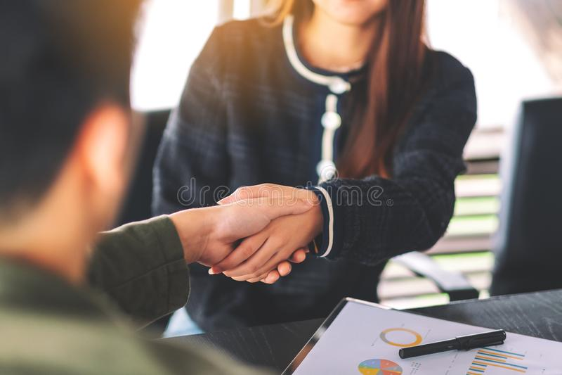Two businesspeople shaking hands in a meeting royalty free stock photography