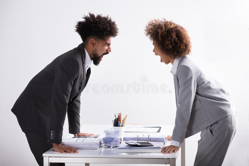 Two Businesspeople Shouting At Each Other royalty free stock photo