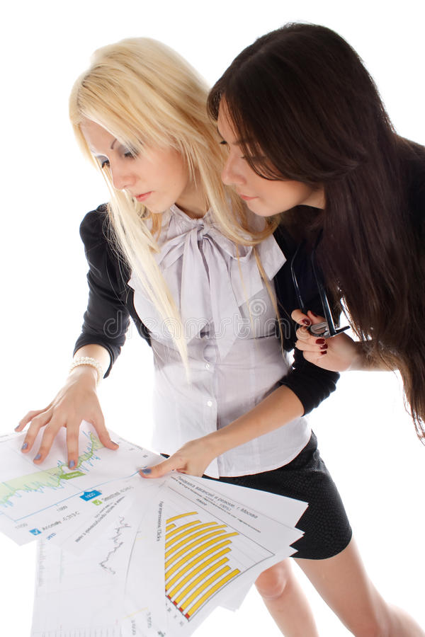 Two businesswoman looks on the graph royalty free stock image