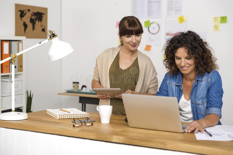 Two businesswoman working together royalty free stock images