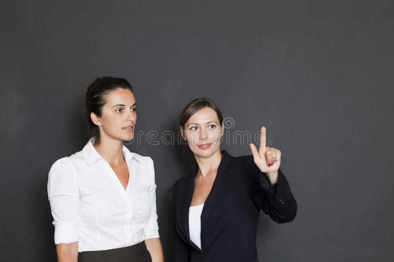 Download Two Businesswomen Pointing On A Virtual Screen Stock Image - Image of formula, think: 26404623
