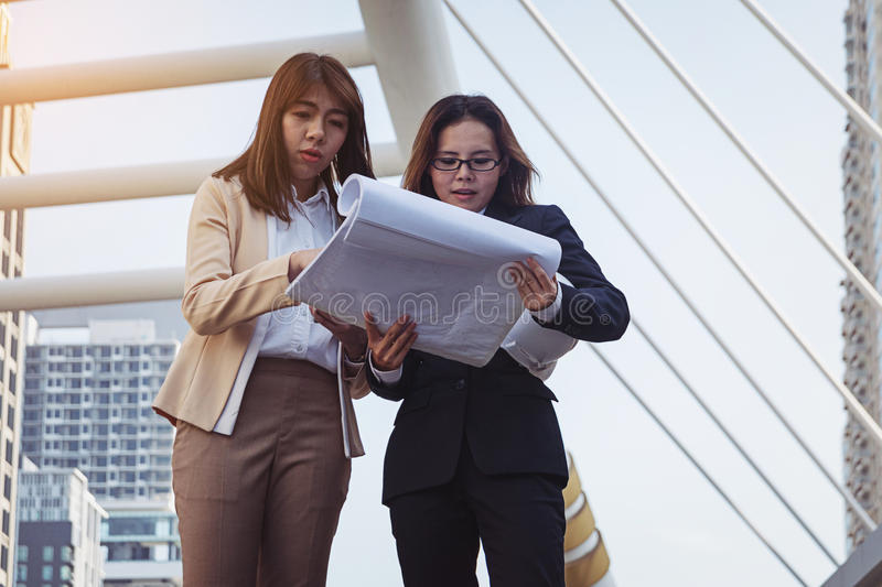 Two businesswomen worker handshaking on construction site royalty free stock photo