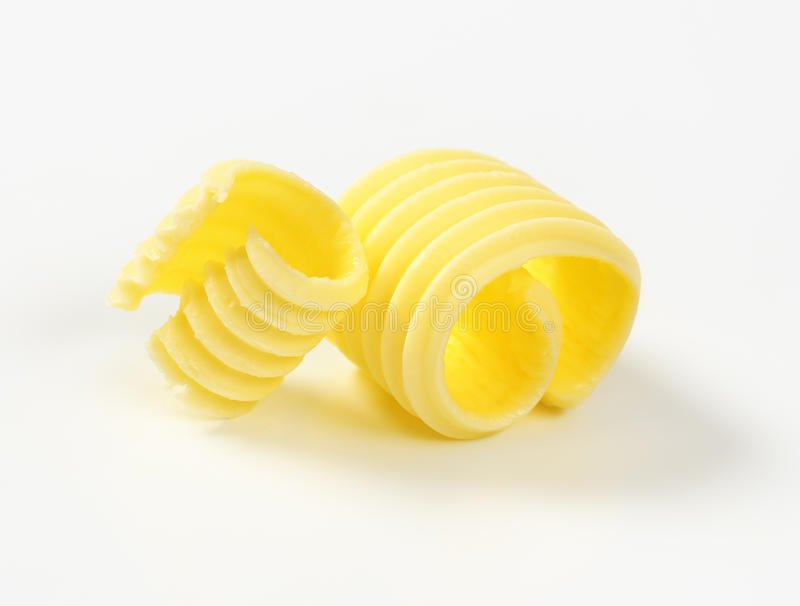 Two butter curls. Curls of fresh butter on white background stock image