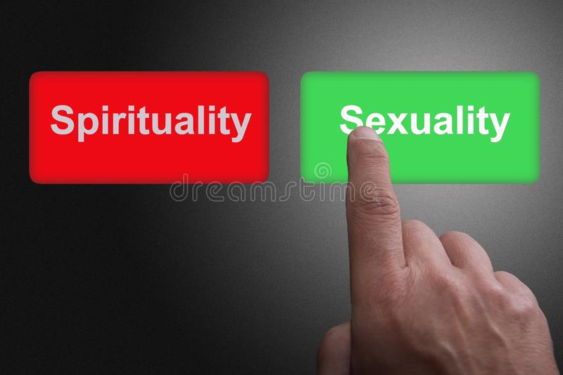 Buttons with written Spirituality and Sexuality and pointing finger, on a gray gradient background stock photo