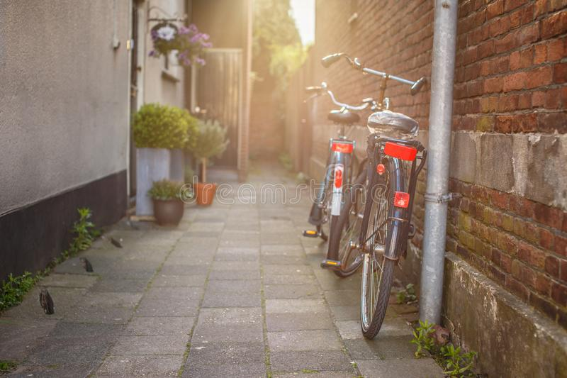 Two bycicles near stone wall stock photo