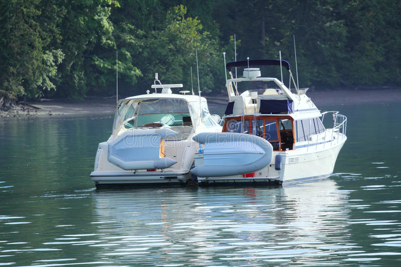 Two Cabin Cruisers Lashed Together royalty free stock photos