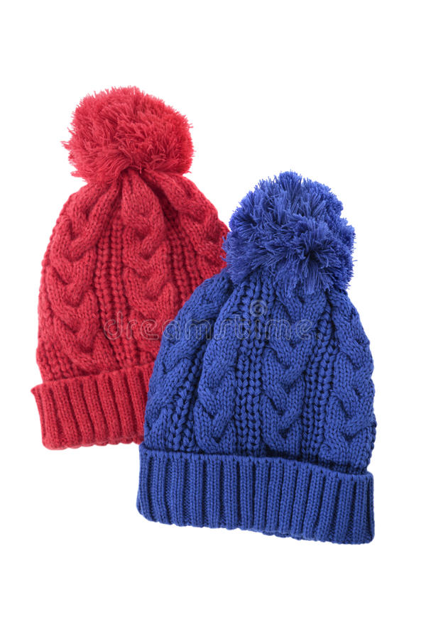 Two cable knit winter ski hats isolated on white background royalty free stock photos