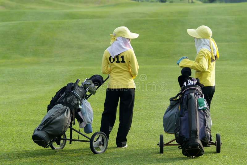 Download Two Caddies At A Golf Course Stock Image - Image: 1414227