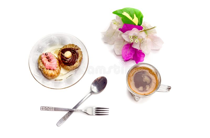 Two cakes and a cup of coffee. Two small cakes `roxakia` with syrup on a plate and a cup of coffee close-up against white background Greek cuisine royalty free stock image