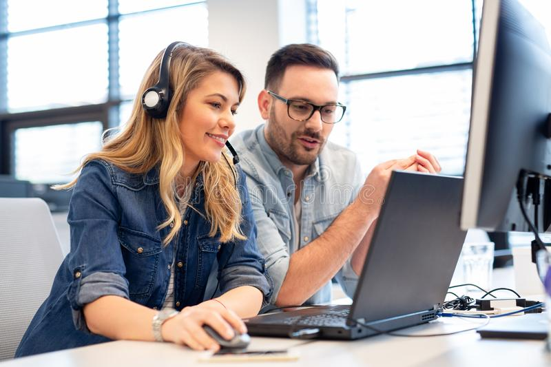 Two call center agents working together. Two young call center agents working together stock photography