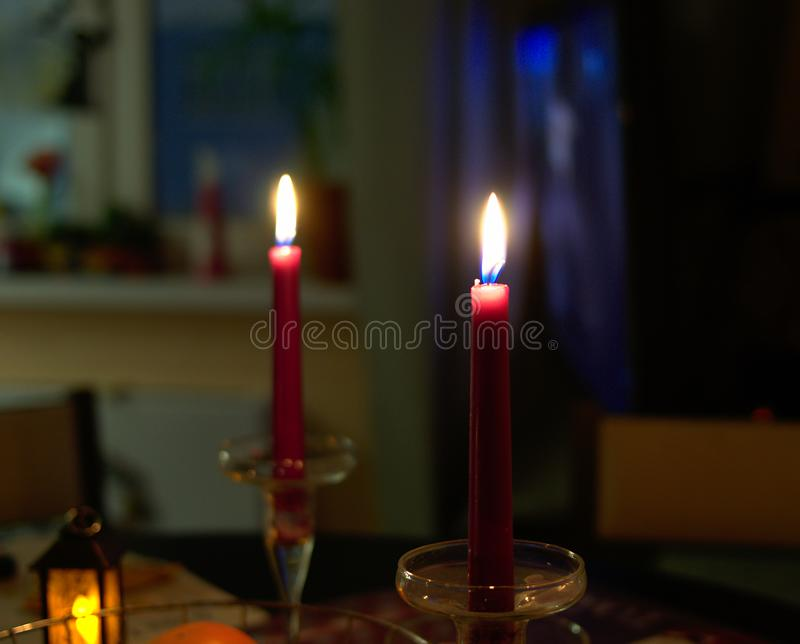 Two candles on the table in the dark stock photo