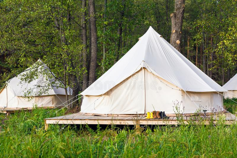 Two canvas bell tents outdoors at forest royalty free stock photography