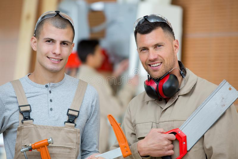 Two carpenters posing to camera stock photography