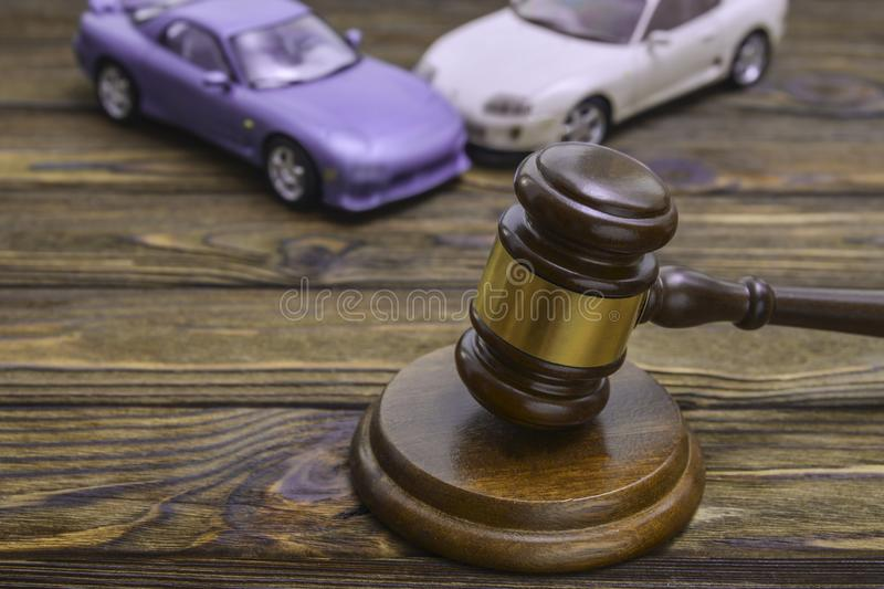 Two cars collided, an accident and a hammer of the judge. royalty free stock images