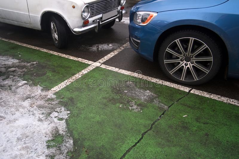 Two cars parked on the parking lot. Wheels and grunge rough texture close up stock photo