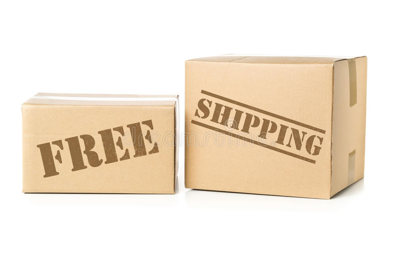 Two carton parcels with Free Shipping imprint royalty free stock photography