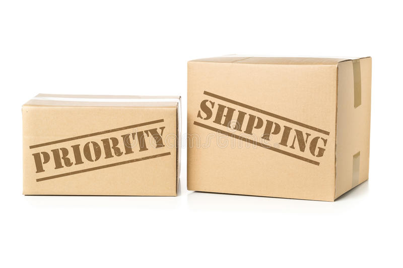 Two carton parcels with Priority Shipping imprint stock photography