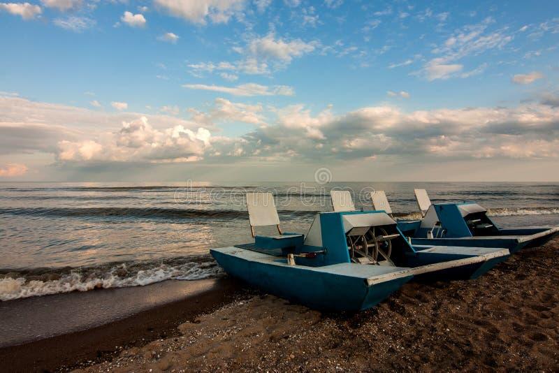 Two catamarans at coastline stock photo
