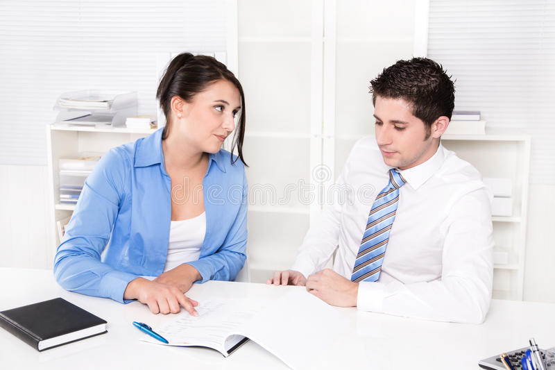 Two caucasian business people working at office. royalty free stock photo