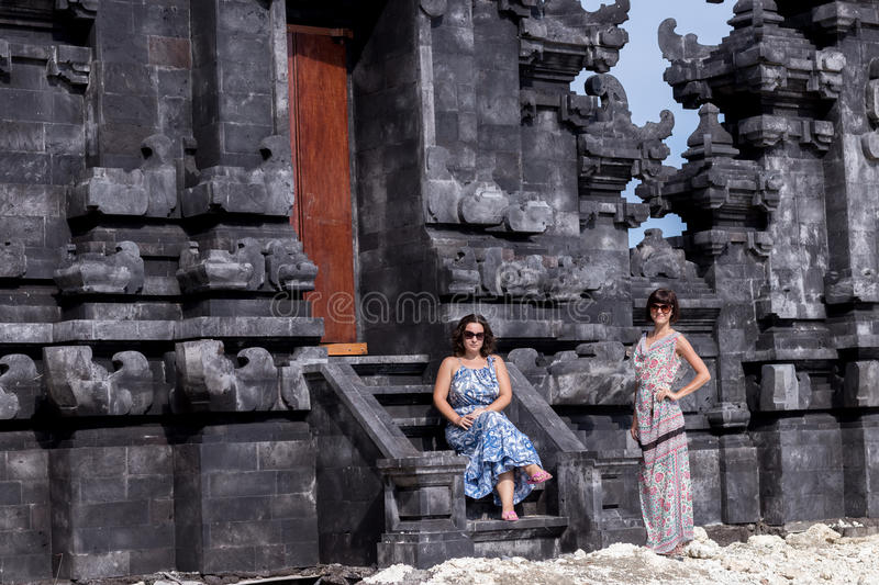 Two caucasian women in sunglasses near the balinese temple. Explore Indonesia, Bali. Two caucasian women in sunglasses near the balinese temple. Explore royalty free stock images