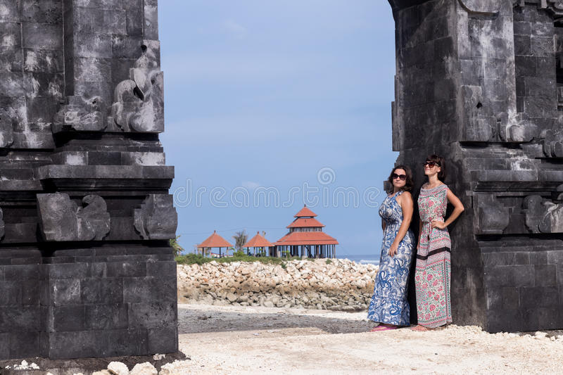 Two caucasian women in sunglasses near the balinese temple. Explore Indonesia, Bali. Two caucasian women in sunglasses near the balinese temple. Explore royalty free stock photos