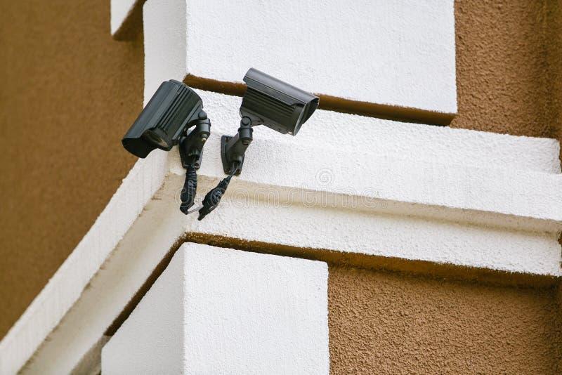Two CCTV black cameras on building corner stock image