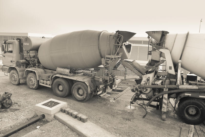 Two cement mixers on construction site stock photos