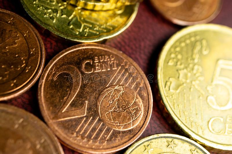 Two cents on the background of other coins Euro cents macro photo stock image