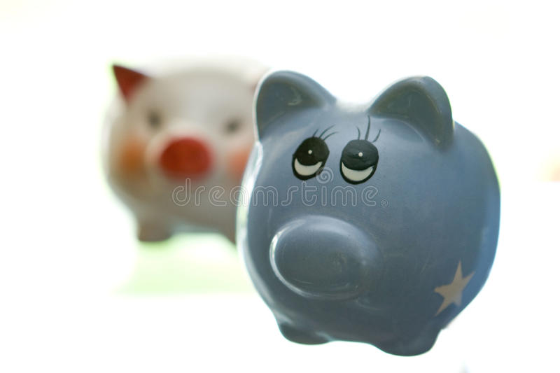 Two ceramic piggy banks stock images