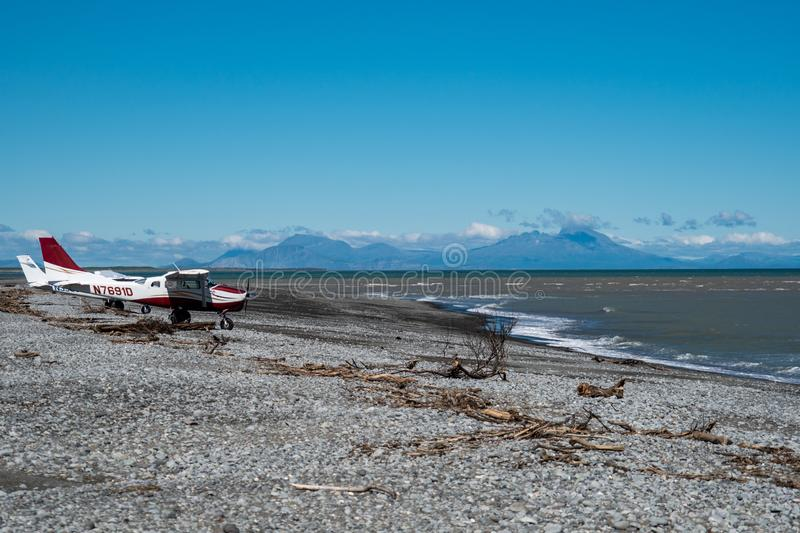 Two Cessna bush planes landed on a beach in Alaska royalty free stock photos
